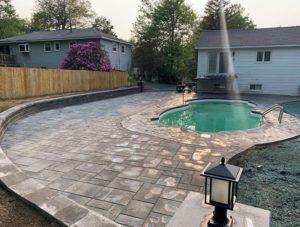 brick-pavers-installed-around-pool-deck