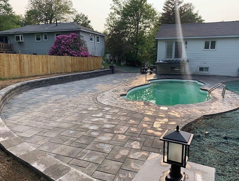 brick-pavers-installed-around-pool-deck