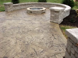 stamped-concrete-with-firepit-and-retaining-wall