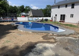 Albany-concrete-hardscaping-project-Broom-finish-pool-deck-1