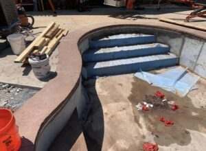 Clifton-Park-hardscaping-project-Versa-Lok-pavers-Belgard-Tile-stamped-concrete-2